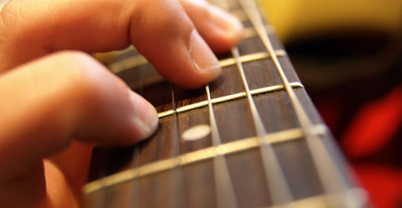 Learn To Play Guitar In No Time!